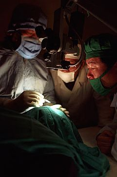 Dr. Ruit (left) educating others on his cataract surgery techniques.